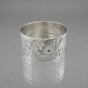 "Antique Aesthetic Movement Sterling Silver Napkin Ring with an incised flower and leaf design. Victorian Era, circa 1880, monogrammed ""DEM""."