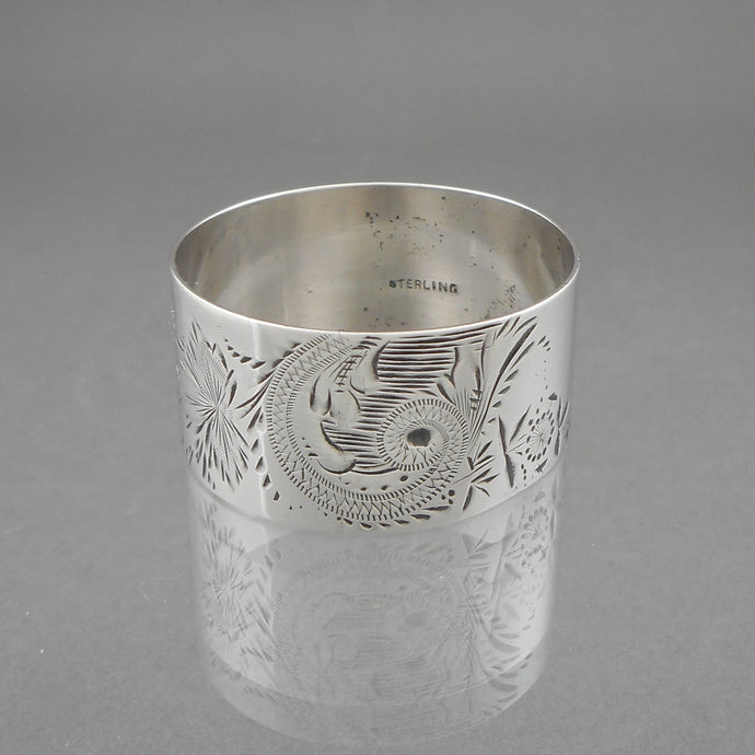 Antique Aesthetic Movement Sterling Silver Napkin Ring with an incised flower and leaf design. Victorian Era, circa 1880, monogrammed