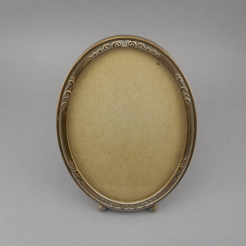Antique Victorian or Edwardian Gold Picture Frame, gilded steel in an oval shape with an impressed design.   Approximately 4 1/8