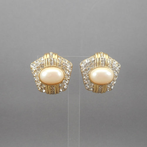 Vintage clip on earrings, by Nina Ricci. Gold tone, for non pierced ears. Circa 1980 with pave set rhinestones and oval faux pearl cabochons.   Each approximately 1