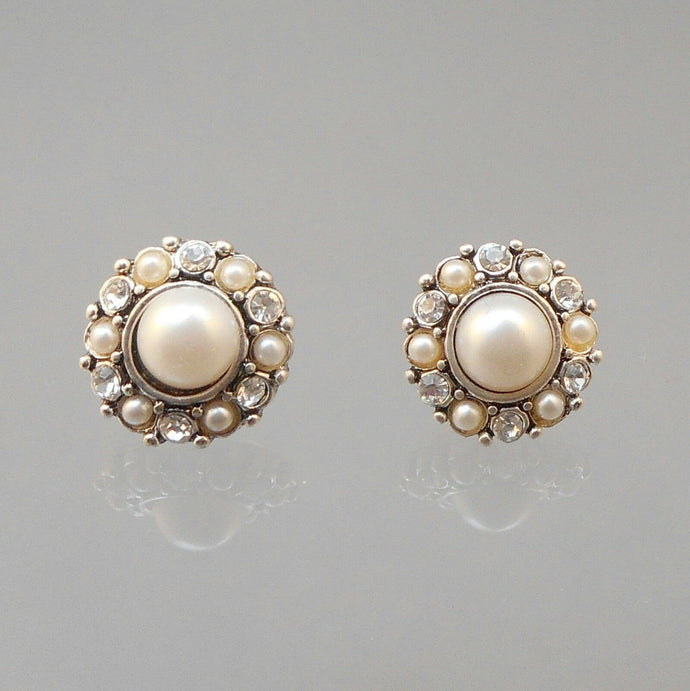 Vintage clip on earrings, silver tone, for pierced ears. Circa 1980 with rhinestones and round faux pearls.  Each approximately 5/8