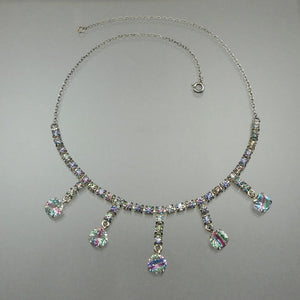 "Vintage collar length necklace, rainbow / iris crystals and rhinestones  in silver tone settings.  Approximately 15""  Excellent vintage pre-owned condition with all stones in place.  FREE US Shipping via USPS standard"