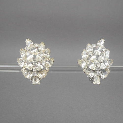 Vintage clip on earrings, signed Weiss. Circa 1950 with marquise and round rhinestones set in silver tone metal. Each approximately 1 1/8