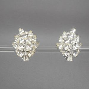 "Vintage clip on earrings, signed Weiss. Circa 1950 with marquise and round rhinestones set in silver tone metal. Each approximately 1 1/8"" x 1 1/2"" Excellent vintage pre-owned condition.  All rhinestones are in place and still bright and clear. A little finish loss on the back of one of the clips. FREE US Shipping"
