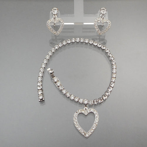 A circa 1950 rhinestone heart charm jewelry set - signed Weiss, a bracelet and earrings. Screw backs for non pierced ears of sterling silver with marcasite stones. Earrings are in excellent vintage pre-owned condition with all stones in place. Minor surface scratches on the reverse FREE US Shipping via USPS standard