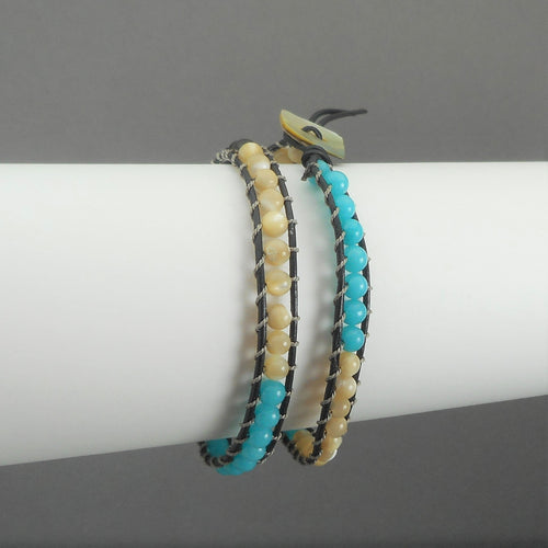 Unisex Leather and Opalescent Stone Bead Bracelet. In the style of Chan Luu, maker unknown, double wrap leather and stone bead friendship bracelet. It can be worn as a choker necklace as well (small size). Turquoise color stone beads FREE Shipping via USPS standard shipping to Continental US locations
