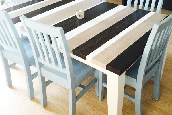 Dining table wrapped in assorted wood grain vinyl