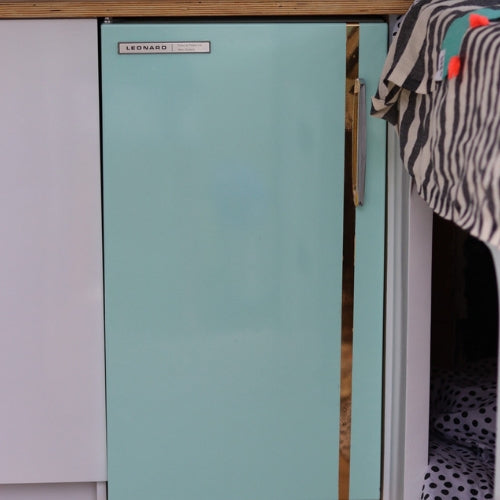 Mint glossy vinyl wrapped fridge in caravan with gold strip