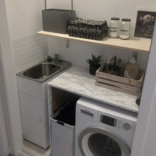 Laundry Hack with self-adhesive vinyl and tiles