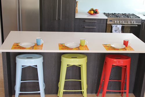 Kitchen breakfast bar with blue, green and red bar stools
