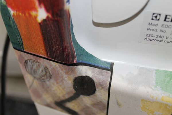 colourful heat stretched vinyl on a dryer