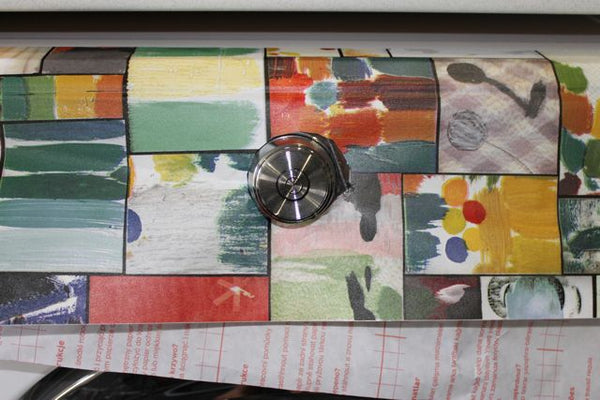 colourful patchwork vinyl with laundry button peeking out in the middle