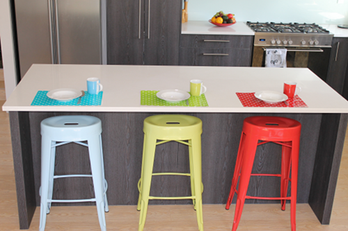 breakfast bar set with blue, green and red bar stool and matching placemats