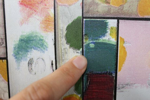finger pointing on black line in colourful patchwork vinyl