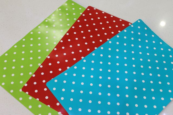 green, blue and red polkadots placemats