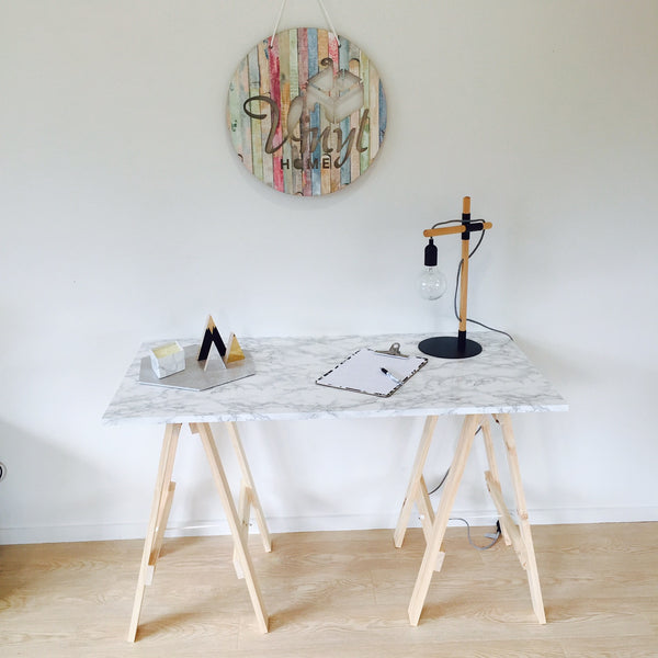 Grey marble vinyl trestle table and Vinyl Home sign