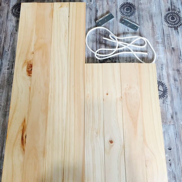 Wooden boards hinges and ropes laid flat on a table