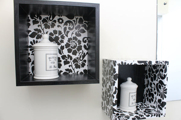two boxed shelves in black and white flower patterned vinyl on white wall