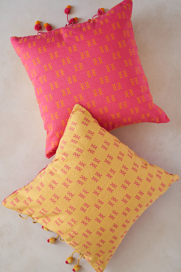 Pink and yellow decorative cushions