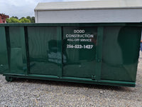 Construction dumpster waiting to be rented by Dodd Construction in Centre, Alabama