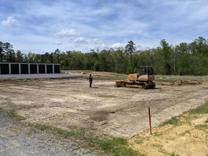 Dozer removing top soil for Dodd Constructino customer to build new storage building in Centre, Alabama
