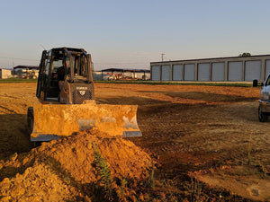 Dozer pushing chert at new storage building site in Centre, Alabama