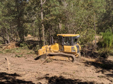 Load image into Gallery viewer, Bulldozer clearing trees and undergrowth on land in Cherokee County Alabama