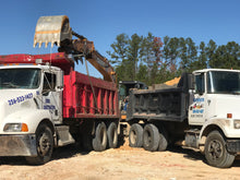 Load image into Gallery viewer, Two dump trucks being loaded with chert