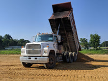 Load image into Gallery viewer, Dump truck delivering chert to new building pad in Centre, Alabama