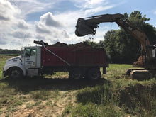 Load image into Gallery viewer, Top soil and dirt being loaded onto dump truck at construction site of new chert building pad in Centre, Alabama