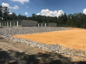 chert building pad with rip rap walls