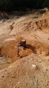 Excavator digging up chert out of chert pit for Dodd Construction in Centre, Alabama
