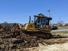 Load image into Gallery viewer, yellow Komatsu dozer pushing dirt pile