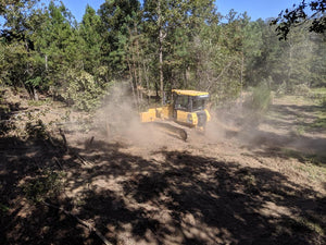 Dozer clearing land and trees in Cherokee County Alabama