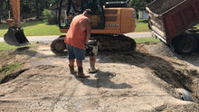 Load image into Gallery viewer, Chert and gravel being compacted during driveway repair by Dodd Construction in Centre, Alabama