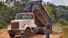 Load image into Gallery viewer, Dump trucks dumps dirt hauled off from Dodd Construction job site