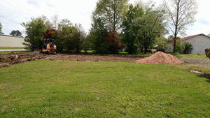 Dozer removing top soil in preparation for a building in Centre, Alabama