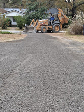 Load image into Gallery viewer, Backhoe spreading gravel on driveway for Dodd Construction customer in Centre, Alabama