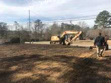 Load image into Gallery viewer, land being graded with heavy equipment on dirt lot