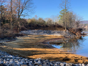 Rip rap on shoreline of lake lot on Weiss Lake in Centre, Alabama for erosion control