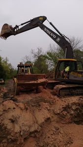 Dozer and excavator work together to prepare land at site for new building in Centre, Alabama