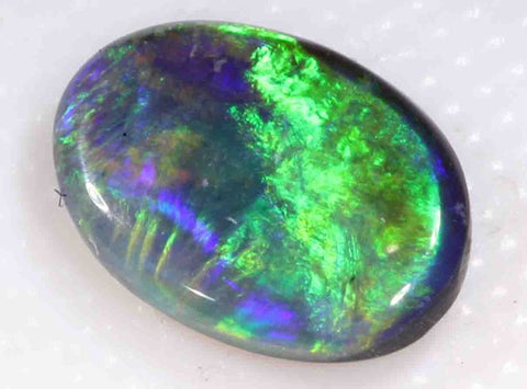 Bright, 1.0CTS Solid Black Opal from Lightning Ridge; Greens and Blues; Brightness 4/5; Body Tone N2;