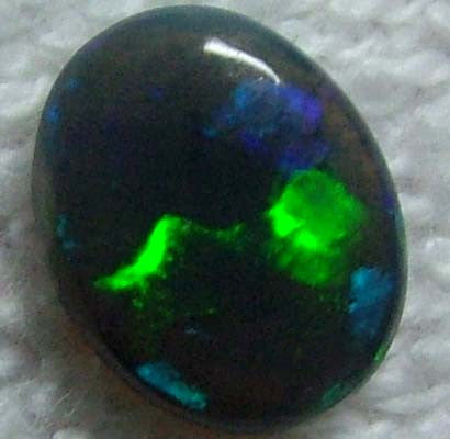 Bright, Solid, 1.35CTS Solid Black Opal; Greens and Blues; Brightness 5/5; Body Tone N1;