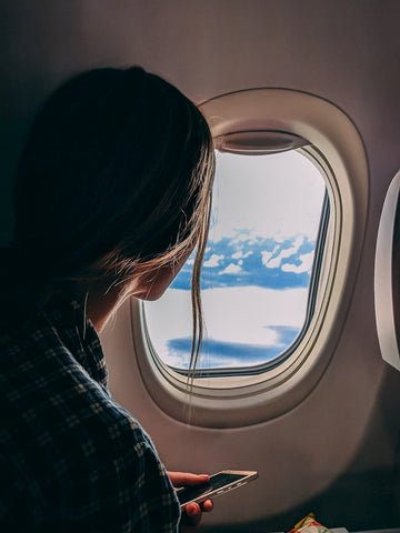 Woman looking out of aircraft window