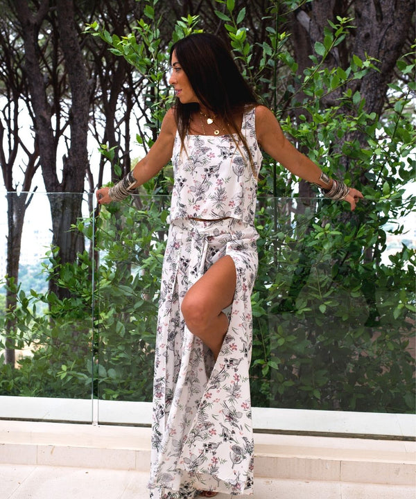 White Floral printed top paired with wide leg high side slit Pants.