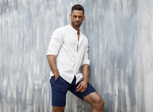 Man wearing shorts with alterations from Tad More Tailoring