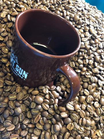Desert Sun mug in fresh coffee beans