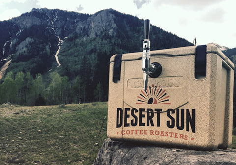 Desert Sun travel coffee dispenser on rock