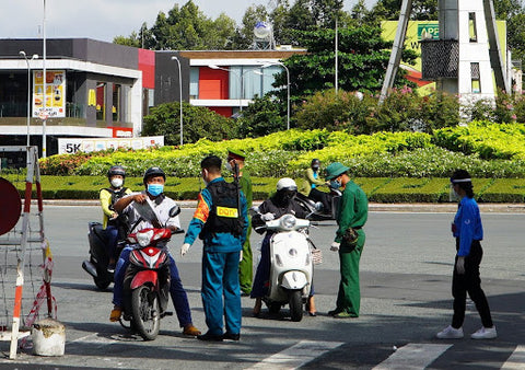 Checking 'city passes' at a checkpoint in Sai Gon