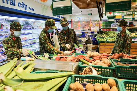 Military forces sorting out residents' food orders in a local supermarket